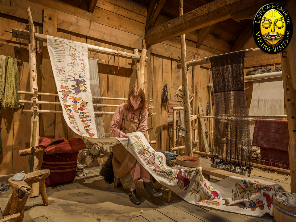 Debs working on embroidered tapestry at Lofotr Viking Museum